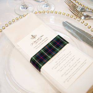 Wrap the Napkins Just because you're having a formal wedding doesn't mean you can't have a little fun with your decor. Add a sophisticated tartan wrap to a formal, white-and-gold place setting to make a dramatic statement.