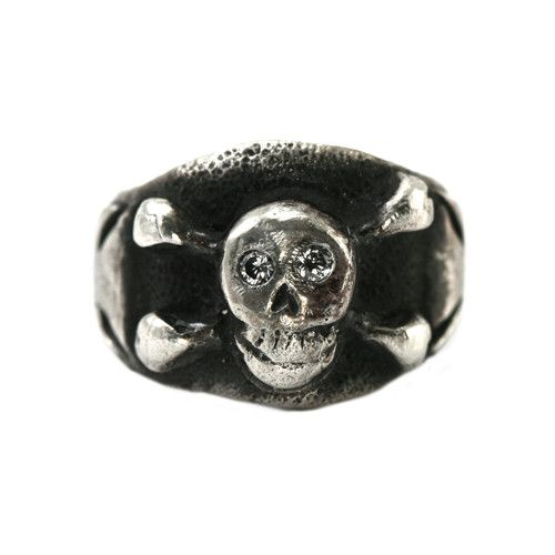 Our Jolly Rodger skull has been framed with our Iron Cross in Sterling Silver or Antiqued Sterling Silver with Cubic Ziconia eyes and a mischievous grin. Universally understood as a symbol of warning,