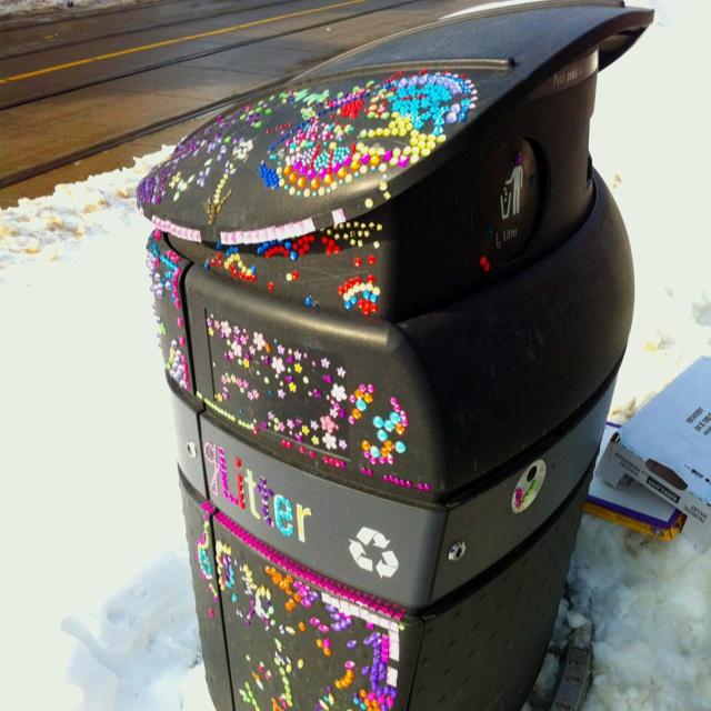 Bedazzled garbage bin in Roncy.