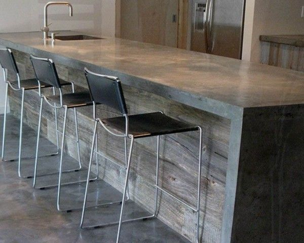 Concrete countertops/reclaimed wood bar....too modern for me but like the materials