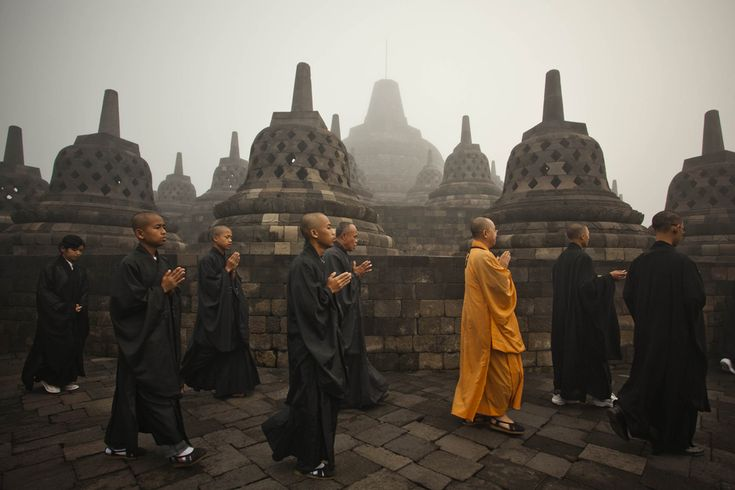 Buddhist monks pray at Borobudur temple in Magelang, Indonesia.