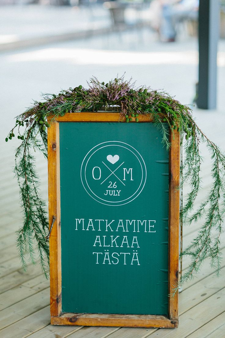 Image by Therese Winberg Photography - A forest green wedding colour scheme at an intimate outdoor coastal ceremony in Finland with DIY wedding dress, flowers and stationery