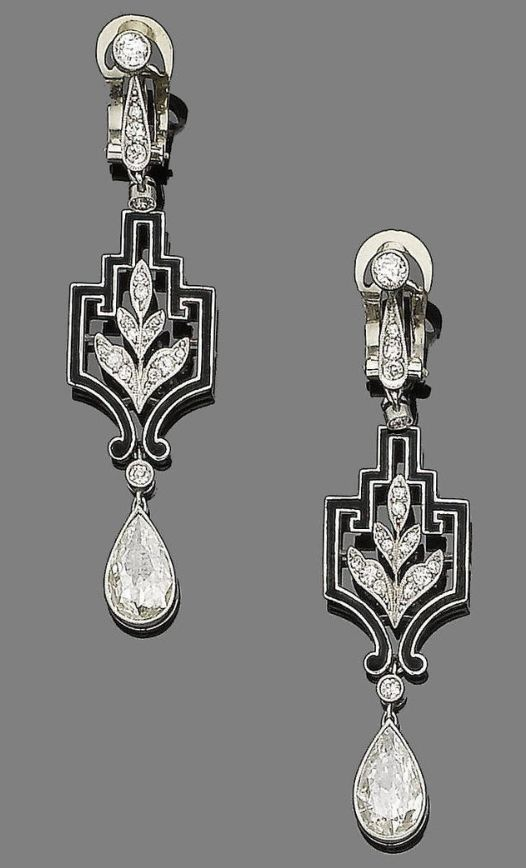 """A pair of art deco diamond and enamel pendent earrings, circa 1925. Each old brilliant and single-cut diamond surmount suspends a single-cut diamond foliate motif within a black enamel openwork geometric plaque, and terminates in a pear-shaped diamond drop, pear-shaped diamonds, approx. 3.30cts total, length 5.6cm."""