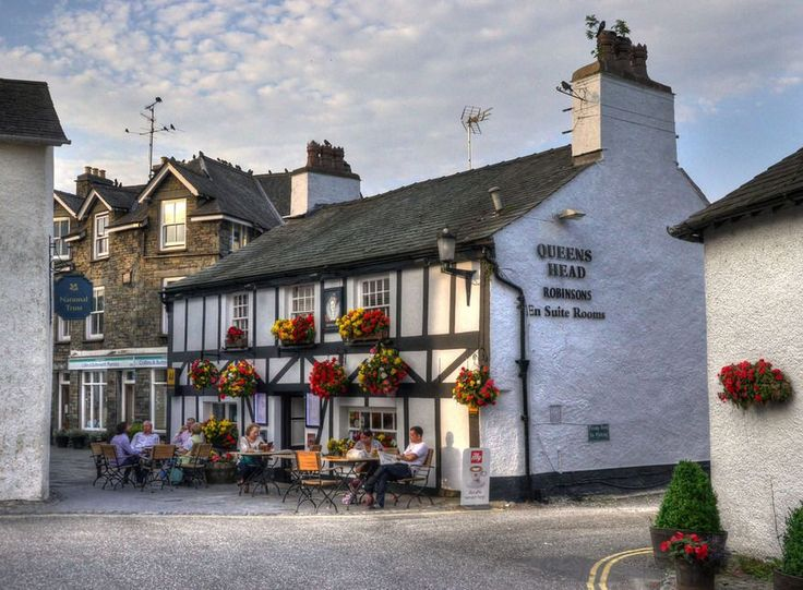 The Queens Head in Hawkshead, a traditional dog-friendly pub serving local cask ales. Discover the most picturesque villages in the Lake District.