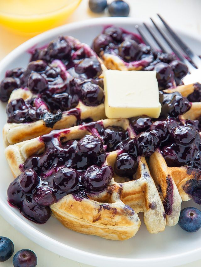 Homemade Greek Yogurt Blueberry Waffles topped with fresh blueberry sauce. Fluffy, crispy, phenomenal.