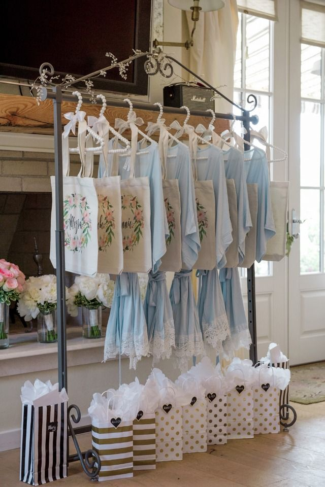 You can give your bridesmaids their gift bags, robes, & bouquets the day of wedding or  rehearsal night.