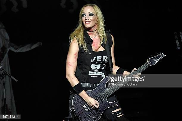 Nita Strauss performs with Alice Cooper at The Louisville Palace on August 7 2016 in Louisville Kentucky