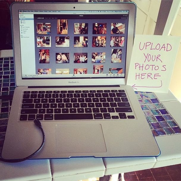 "We had a brunch the day after our wedding and I set up an ""Upload Your Photos Here"" laptop and HUGE sign"