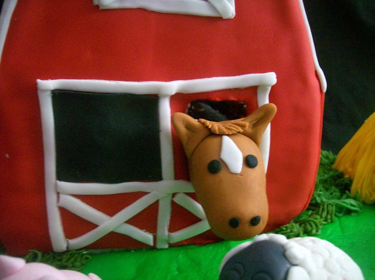 Barnyard Cake All of the animals were made out of fondant, the sheet cake was iced in butter cream and then airbrushed. The barn was carved...