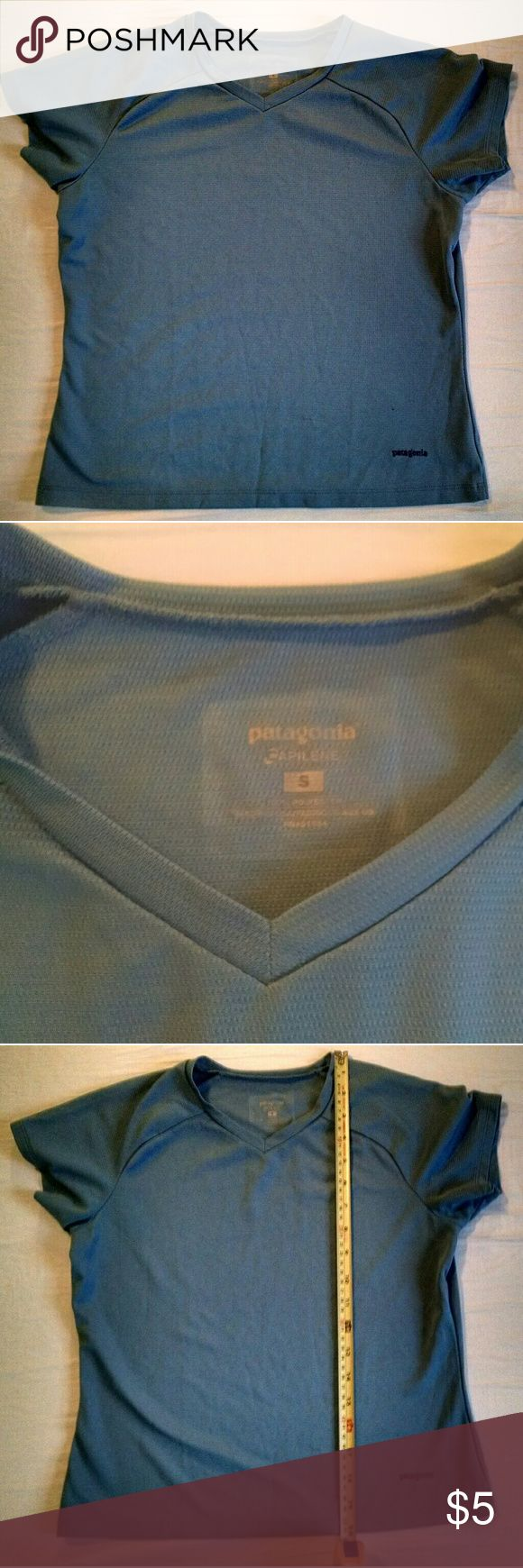 Patagonia wicking workout tee Blue workout tee by Patagonia. 100 percent polyester. Great for biking or running in the warm weather. Two snags in front near the bottom. Worse of the two shown in the last photo. Patagonia Tops Tees - Short Sleeve