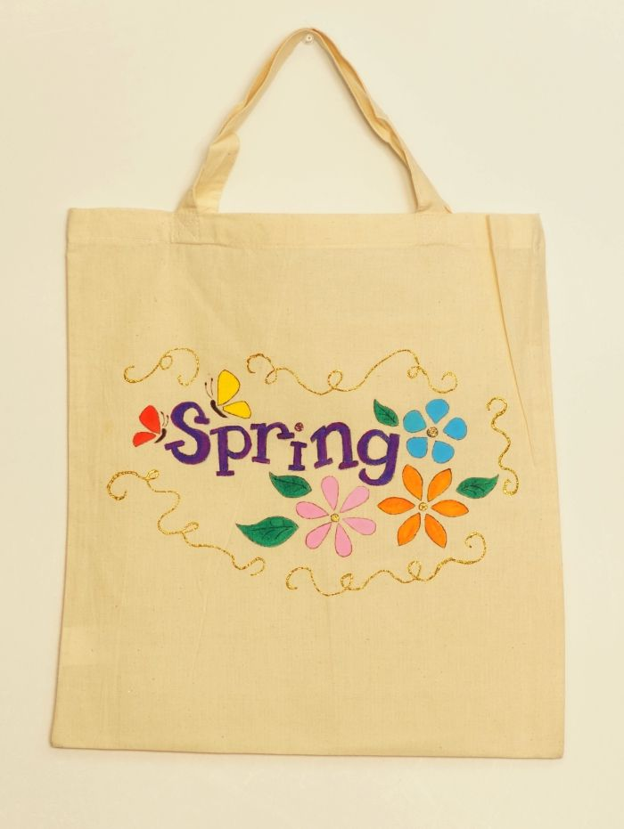 Tote bag handmade painted with textile colors and glitter. Spring pattern design.
