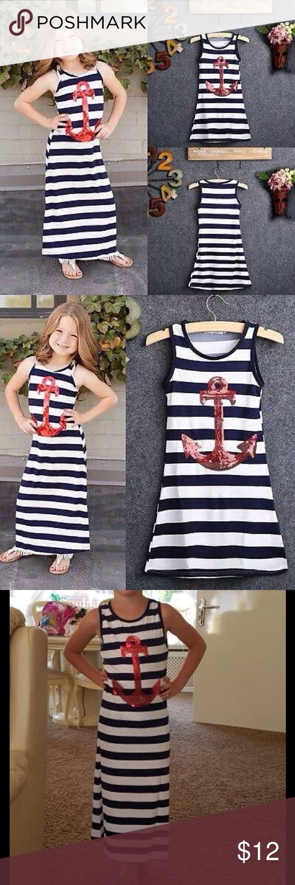 Anchors Away! Sequin anchor dress. Deep navy stripes w/white and a red sequin anchor.  Tank cut long dress.   Fabric is synthetic, similar to swimsuit fabric, which makes this PERFECT for the beach and summer getaways. Throw it over a damp swimsuit to get to dinner NO PROBLEM!   Just ONE available, don't miss out!  Boutique brand. VOGUE Fashions Dresses Casual