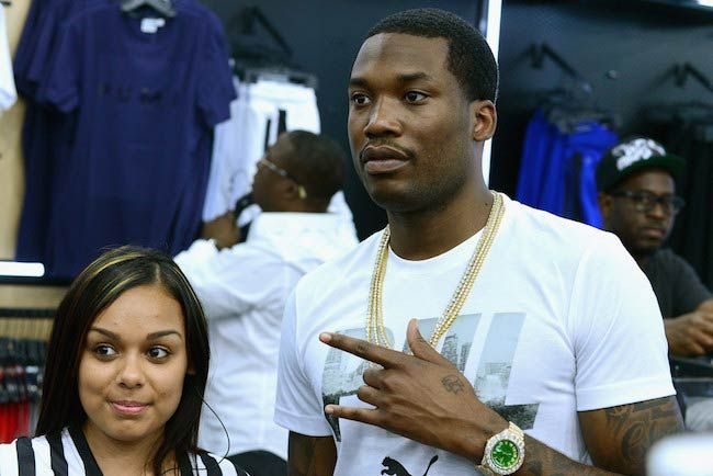 Meek Mill (Right) with a guest at the Meek Mill Debut of Dreamchasers x PUMA Collab at New Puma Lab in July 2016...