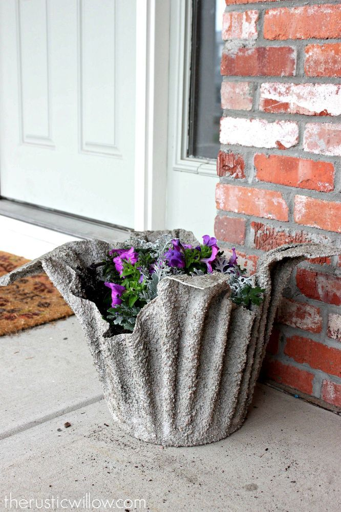 Oh my GOSH!!  A planter made from soaking a towel in concrete!