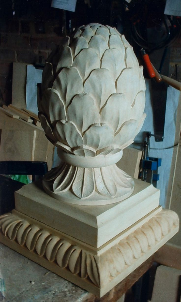 The finished carving on its base - pineapple, base, ornament