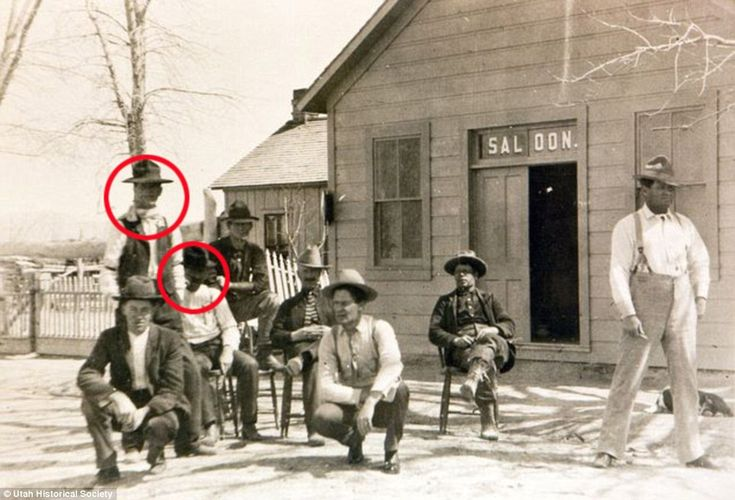 A rare shot of Butch Cassidy and the Sundance Kid with their gang. The saloon hangout of The Wild Bunch in 1889. Circled are Harry Longbaugh (The Sundance Kid) and the man sitting on the chair beside him is Butch Cassidy.