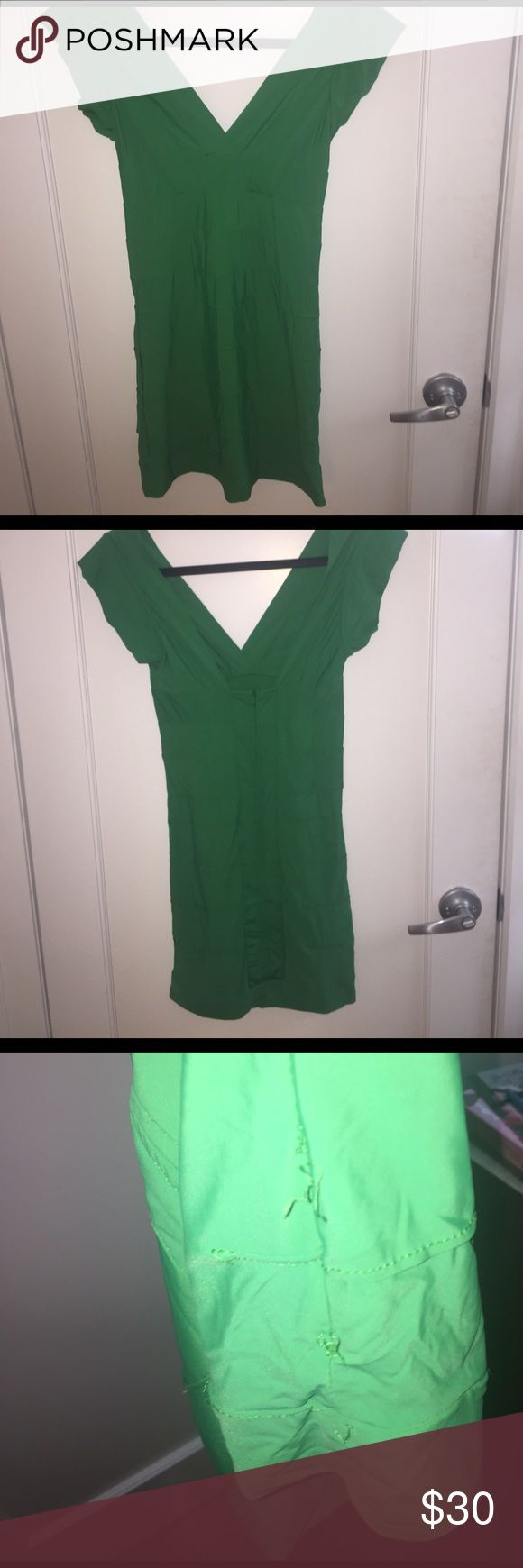 Sexy green bandage dress 🌟 Green emerald short sleeved v neck bandage dress. Minor wear as shown in photos on the side Seam but otherwise good condition. Just needs to be ironed. Seriously the prettiest green and looks even better on.  Back zipper closure.  All offers are considered and I offer a bundle discount if you purchase more than one item 😘 Urban Outfitters Dresses Mini