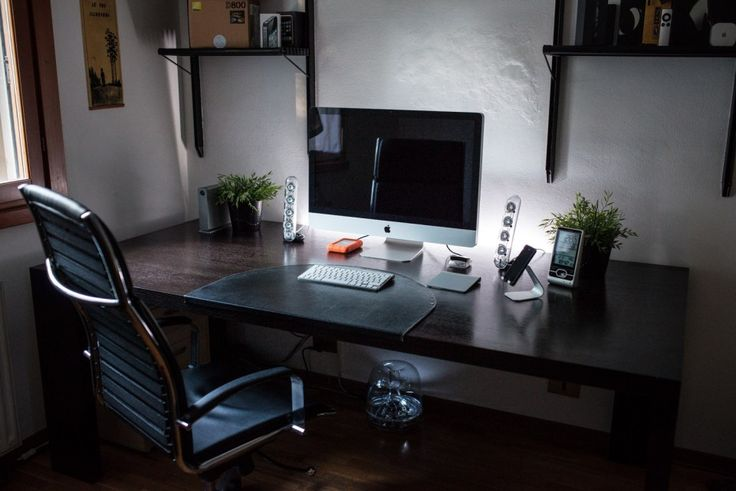 I love how this office space blends high tech and rustic, sleek and soothing.