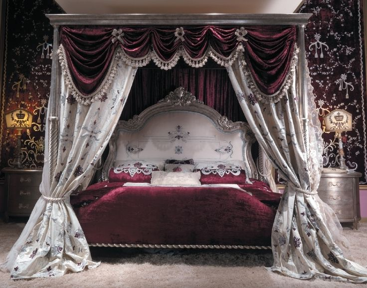 Master bed with canopy and embroidered headboard. Scarlet red