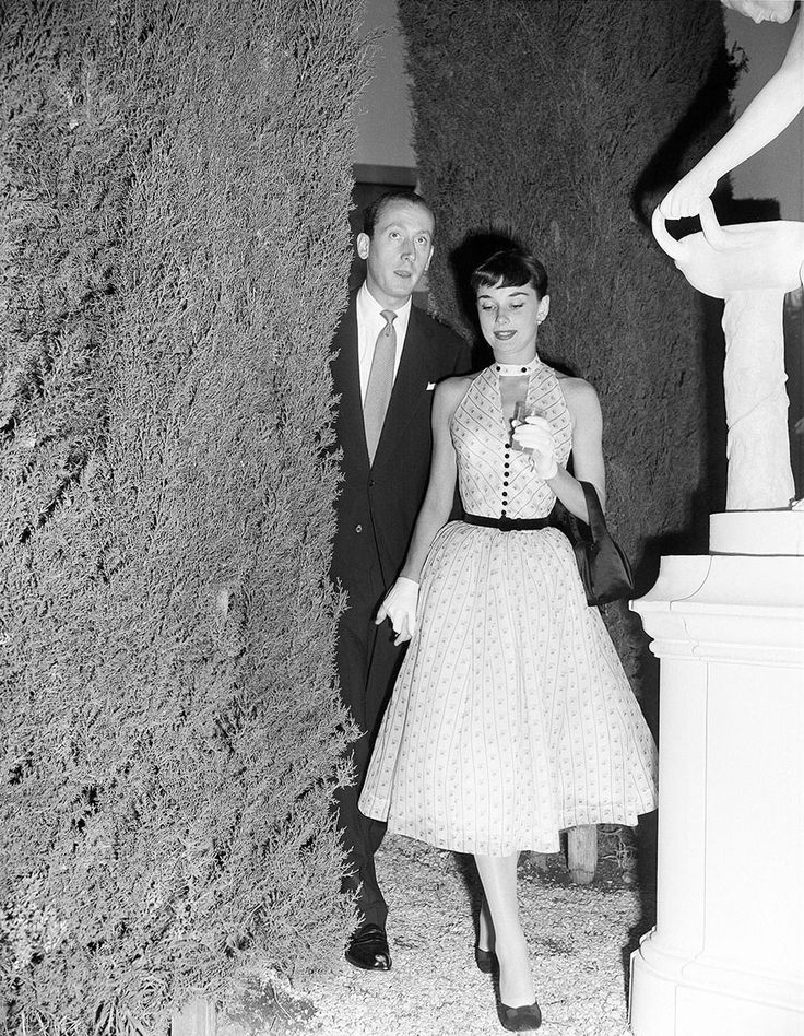 Audrey Hepburn and fiancé James Hanson at a cocktail party on the set of Roman Holiday, in Rome's Cinecitta on June 26, 1952