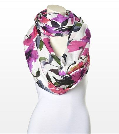 Wrap yourself in this fresh floral cotton scarf! Pair it with one of our v-neck tees.