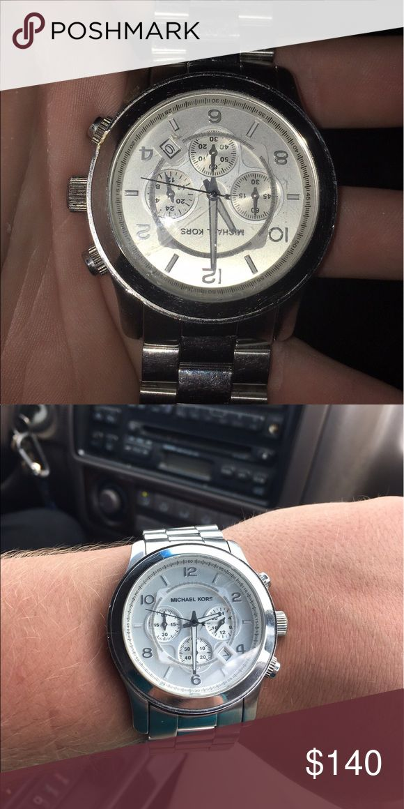 Mk men's watch Ok condition. White face silver band. KORS Michael Kors Jewelry