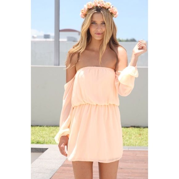 Sabo Skirt peach off the shoulder dress This dress is from an Australian label, Sabo Skirt, and is a size 8 but US 4 (small). Never worn, perfect condition. The arms hang off the shoulder and the waist is tight around the torso. Sabo Skirt Dresses Mini