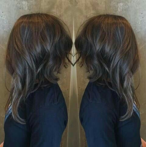 Inverted long bob with curls.                                                                                                                                                     More