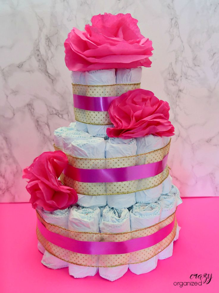 Step by step instructions to make your own diaper cake for your next baby shower!