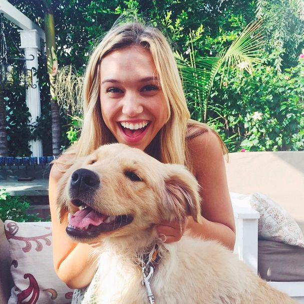 Alexis Ren models with dogs
