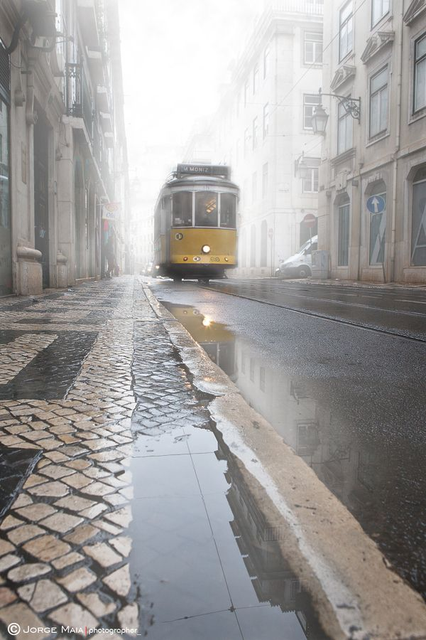Streetcar in Lisbon, Portugal. Lisbon was an amazing and beautiful city. We kept eating at the same amazing place with the best roasted chicken you've ever had.
