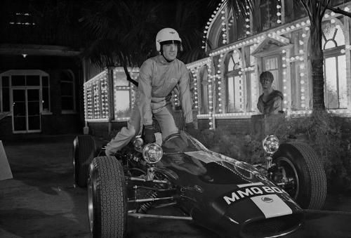 "Peter Sellers Racing Time  by Terry O'Neill  Peter Sellers getting into a sports car while racing driver Stirling Moss looks on during the filming of espionage spoof 'Casino Royale', 1967.  Limited Edition Silver Gelatin Signed and Numbered  12"" x 16"" / 16"" x 20""  20"" x 24"" / 20"" x 30""  24"" x 34"" / 30"" x 40""  40"" x 60"" / 48"" x 72""  For questions or prices please contact us at info@igifa.com  IGI FINE ART"