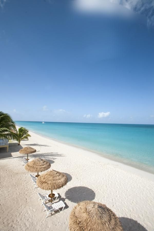 Barbuda - white sand beach with little development and voted most favorite by Islands.com