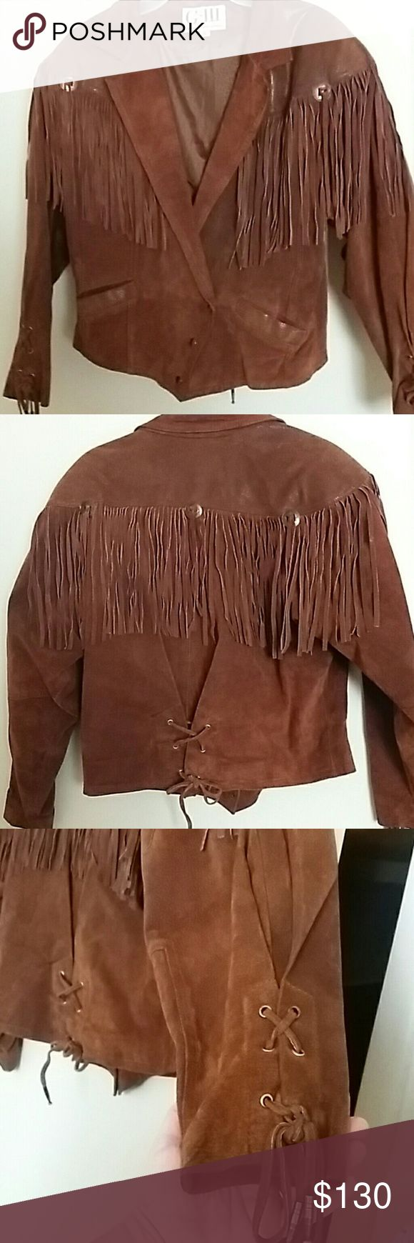Size L 100% Suede Leather Jacket w/ Fringe Detail Gorgeous Brown Leather Jacket with fringed yoke, front and back. The sleeves and back have leather laces to adjust for custom fit. The yoke and pockets are reptile print with a slight sheen. The pictures make it look more shiny than it is. No attention to detail was spared!  The only two flaws are with the actual leather laces...the sleeve lace has the metal endcaps missing and the back lace has one cap missing. This does not affect the…