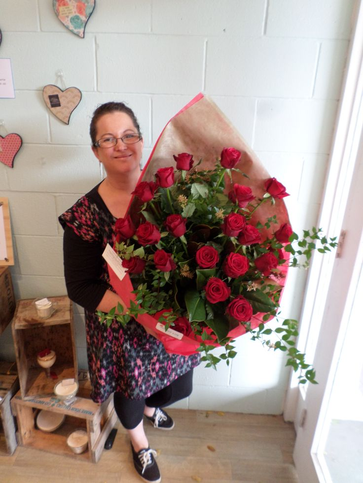 24 Red roses beautifully wrapped and put into a water filled box. Created by Florist ilene