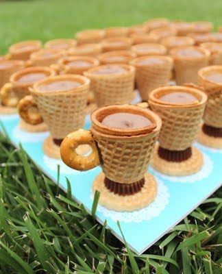 Cookies in the shape of teacups. How cute is this!!! Ingredients vanilla sandwich cookie wafer, reese's peanut butter cup, ice cream sugar cone, circle pretzel, filling (melted milk chocolate)
