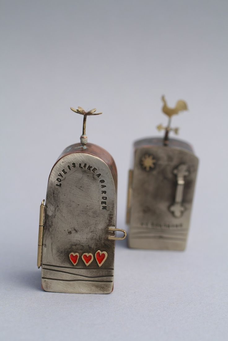 Bronwen Tyler-Jones: mini metal box amulets. Like the door handle on the back one.