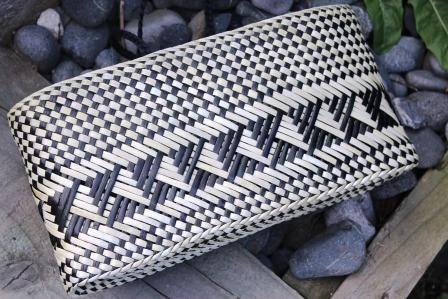 Flat bottom, black handles.