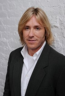 Ron Eldard (Rod Holt)