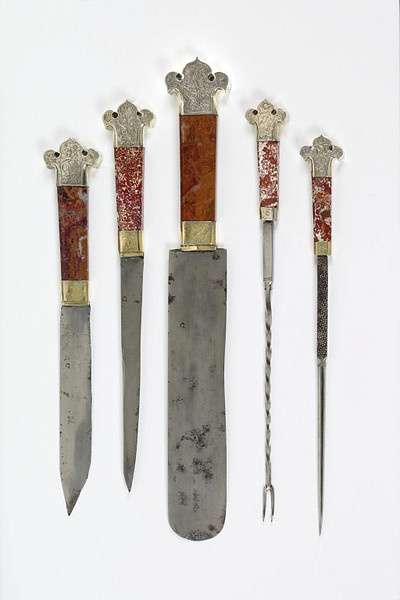 Cutlery set  Place of origin: Germany (made)  Date: late 15th century (made)  Artist/Maker: Unknown  Materials and Techniques: Steel, with jasper handles and gilded silver mounts Dimensions  [Skewer] Length: 31.1 cm, Width: 3.4 cm, Depth: 1.2 cm, Weight: 0.1 kg  [Fork] Length: 32.9 cm, Width: 3.4 cm, Depth: 1.3 cm, Weight: 0.08 kg  [knife] Length: 31.2 cm, Width: 4.7 cm, Depth: 1.5 cm, Weight: 0.12 kg  [knife] Length: 38 cm, Width: 5.2 cm, Depth: 1.7 cm, Weight: 0.22 kg