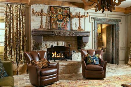Beefy wood mantel on stone fireplace