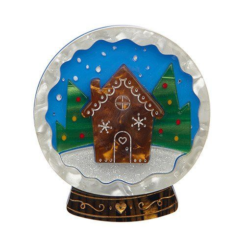 A magical and multi-colour snow globe brooch from Erstwilder, showing a gingerbread house in the woods. Laser cut, hand assembled and hand painted, presented in a branded box as shown, with a cute teapot tag.