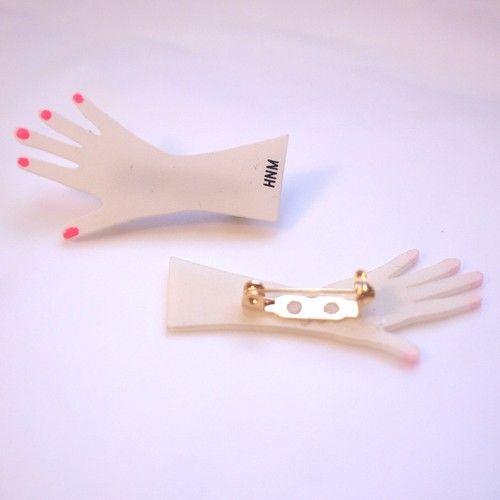 Hand brooch