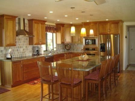 natural wood cabinets, light granite, island
