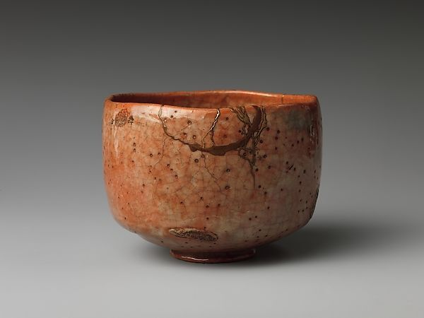 Teabowl | Japan | Edo period (1615–1868) | The Met  Date: ca. 1750 Culture: Japan Medium: Clay, closely pitted, covered with rich glazes (Raku ware, style of Koetsu)