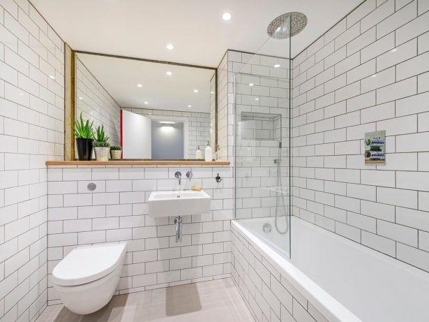 30 Best Practical Bathroom Tile Ideas To Inspire You Beige Floor Tile City White Subway Tile Wallt Edgy Fla London Metro Tile Bathroom Vibrant White Bathroom White Subway Tile Bathroom Shower Tub Combo Recessed Lighting Industrial