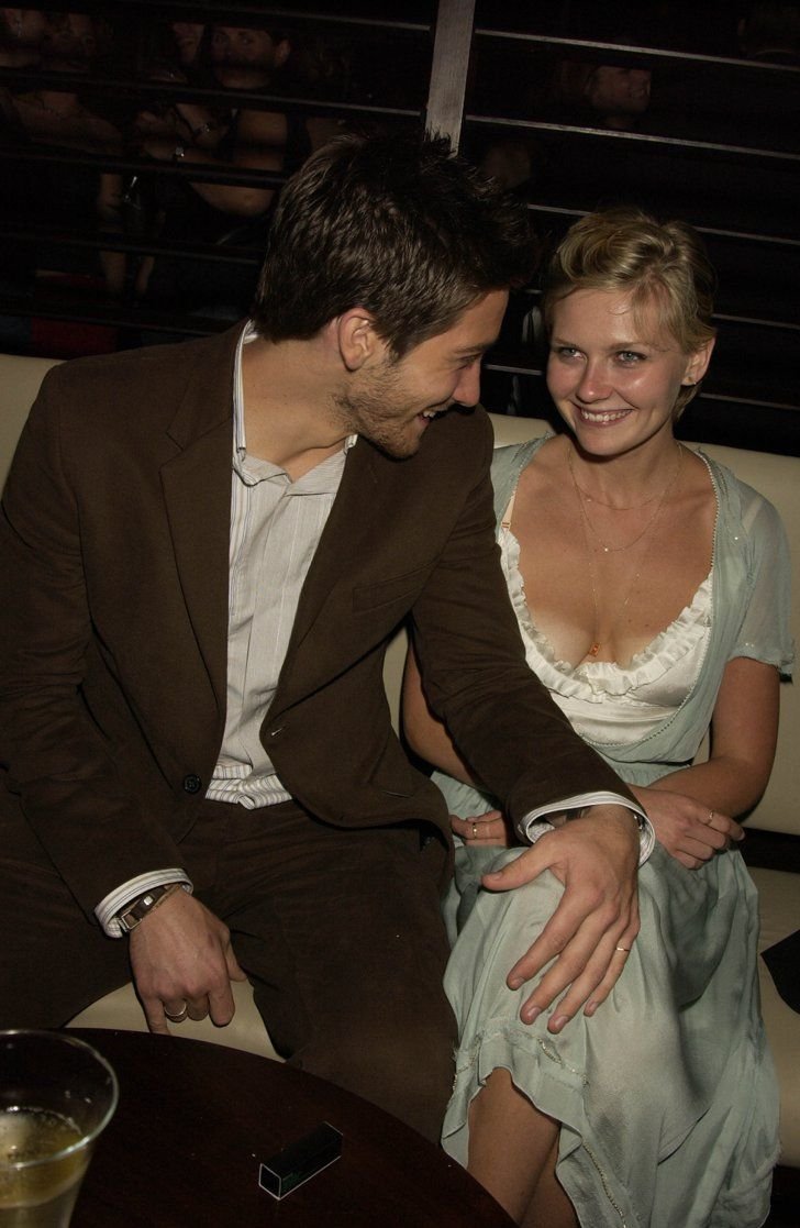 """Pin for Later: 37 Pictures of Jake That Will Have You Saying """"Gyllenhaal-alujah!""""  Jake and his then-girlfriend Kirsten Dunst made a cute couple at the London afterparty for The Day After Tomorrow in May 2004."""