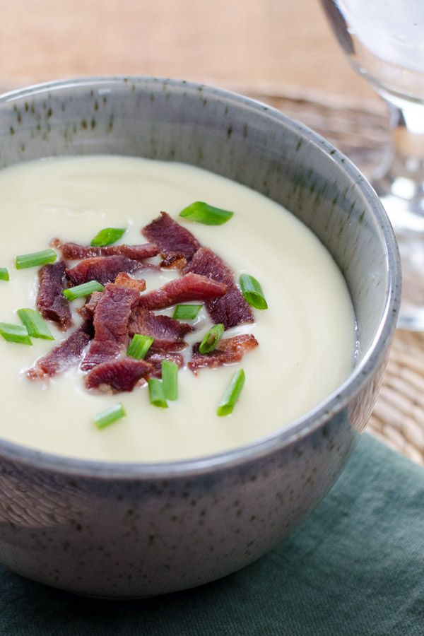 This easy cauliflower celeriac soup with bacon is so creamy, you won't believe it's gluten-free and paleo — without any added flour or thickeners.
