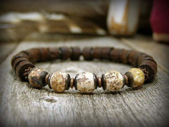 Earthy mens bracelet in colors of brown and beige using matte wood jasper and rustic wood tube beads.  Such a earthy rustic style for that back to nature kinda guy!  A great beaded bracelet to wear alone or add with other stretch bracelets for a stack look.