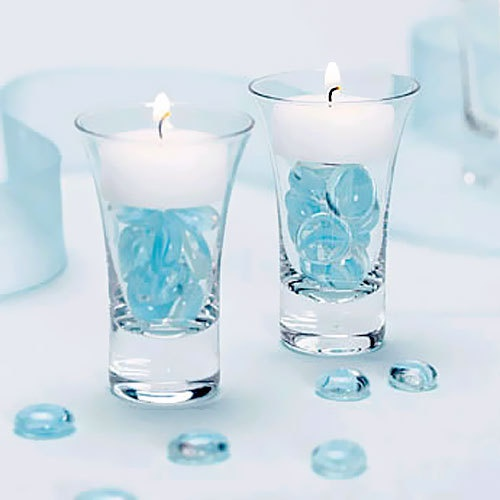glass pebbles and tealights in glasses  http://www.beau-coup.com/cordialglasstealightholders.htm